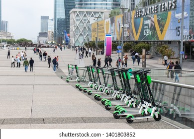 Paris, France - 05 19 2019: Electric scooters are placed all over the city of Paris. Here they are at La Défense