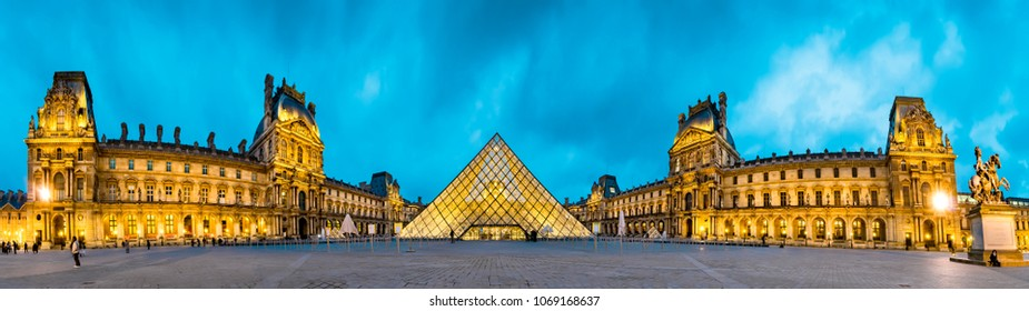 Paris, France - 05 May, 2017: Panoramic view of famous Louvre Museum with Louvre Pyramid at sunrise. Louvre Museum is one of the largest and most visited museums worldwide