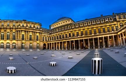 Paris, France - 05 May, 2017: Daniel Buren art pieces at Le Palais Royal in Paris at twilight, France