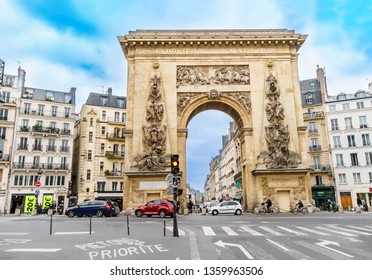 Paris, France - 05 May, 2017: Traffic at Porte Saint-Denis, built in 1672, designed by architect Francois Blondel at the order of Louis XIV in Paris, France.