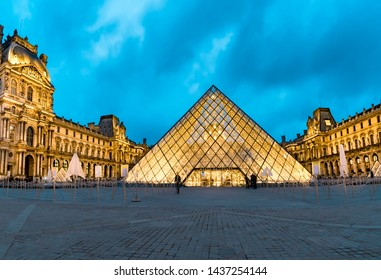 Paris, France - 05 May, 2017: Panoramic view of Louvre pyramid at dusk, the most visited museum in the world