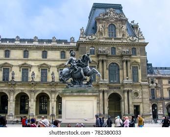Paris, France - 05/10/2010 - Paris, France - Louvre and Louis XIV Statue