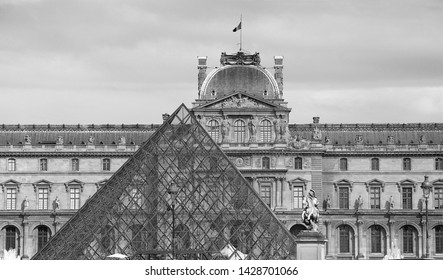 Paris, France, 05/20/2014, black and white gray Louvre facade with glass triangle france big art museum paris exterior landmarks