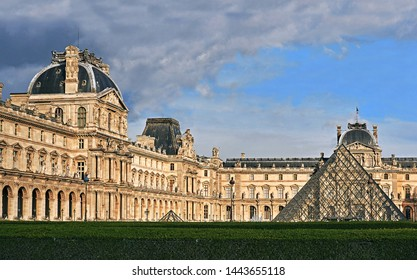 Paris, France, 05/25/2017  Louvre facade with glass triangle france big art museum wide panoramic central square
