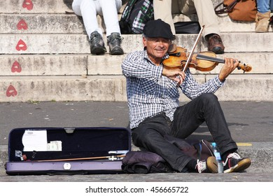 Paris, France - 06 August 2013: Street musician playing the violin in Montmartre.