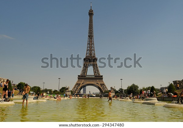 PARIS, FRANCE - 07 July 2015:People cooling using public fountains in the hottest day in the last 10 years in France on July  01,2015 in Paris, France