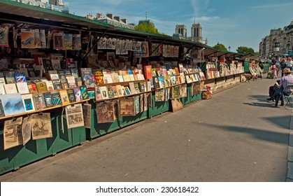 PARIS, FRANCE - 07 SEPTEMBER, 2014: Second-hand book market on quay of river Seine near cathedral Notre Dame de Paris on 7 September 2014. It is based in 16 century.