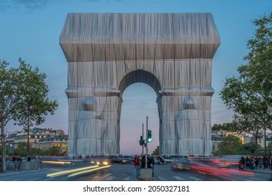 Paris, France - 09 30 2021: Place Charles de Gaulle. L'Arc de Triomphe, Wrapped by night