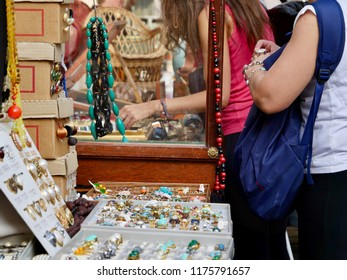 Paris, France - 09/09/2018 : Women who choose jewelry at the flea market in the place des Abbesses, in Montmartre, on Sunday