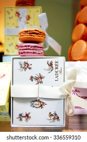 Paris, FRANCE. 09.26.2015. Famous Parisian Macaroons from Laduree store. A larger view from the store window