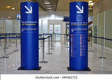 PARIS, FRANCE -1 JAN 2017- Sign for passport control separating lines between All Passports and EU and Schengen passports at the Roissy Charles de Gaulle International Airport (CDG) near Paris.