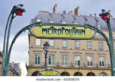 PARIS, FRANCE -1 JUL 2016- Landmark ornate entrance to the Paris Metropolitain (subway)  station in Paris.