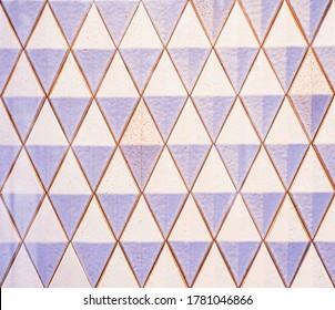 Paris, France, 1 March 2020: Rose pastel mosaic decoration tile wall texture background.  Beautiful pattern.