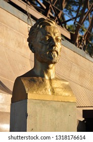 Paris, France, 10 18, 2014: The bronze gilded bust of Gustave Eiffel by Antoine Bourdelle unveiled in 1929, located at the north pier of the Eiffel Tower on the Champ-De Mars