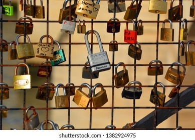 PARIS FRANCE 10 22 2014: Love Locks in Paris. A love lock or love padlock is a padlock which sweethearts lock to a bridge, fence, gate, monument, or similar public fixture to symbolize their love.