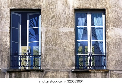 PARIS, FRANCE -10 JULY 2015- Fake trompe l oeil paintings of imaginary windows on a wall (Fenetres Imaginaires) by artist Fabio Rieti across from the Centre Georges Pompidou museum in Beaubourg.
