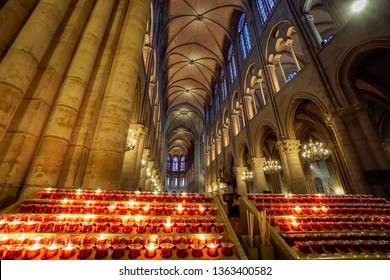 Paris, France - 10 May, 2018: Lit Candles inside church Notre Dame de Paris, France