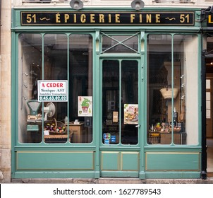 Paris, France 10-09-18. Old, vintage Paris épicerie, grocery store shop front facade in The Marais with light green wood trim around the windows and door
