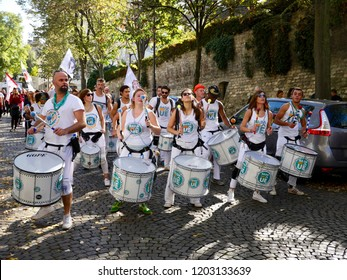 Paris, France - 10/13/2018: Junot Avenue, the girls and boys of the Brazilian music group Badauê Batucada parade and hit their drums, for peace in the world at the harvest festival of Montmartre