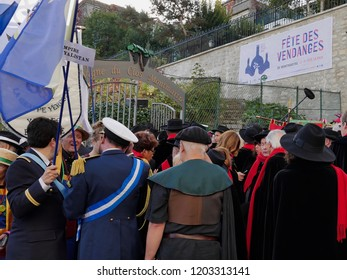Paris, France - 10/13/2018: The members of the Republic of Montmartre, in full ceremonial dress, enter the vineyards of Clos Montmartre on the occasion of the harvest festival