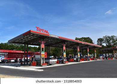 """Paris, France, 11th of September 2019.  TOTAL brand on top of a gas station, Total S.A. is a French multinational oil and gas company founded in 1924 and one of the seven """"Supermajor"""" oil companies."""