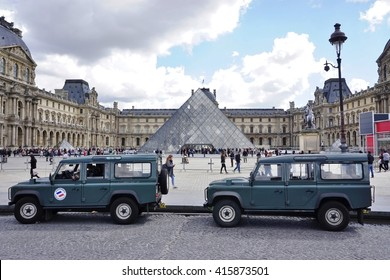 PARIS, FRANCE -12 APRIL 2016- An armored military vehicle for the French Vigipirate Sentinelle police program is parked in front of the glass pyramid at the Musee du Louvre.