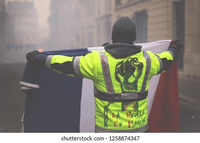 """Paris, France, 12/08/2018 : the """"yellow vests"""" are demonstrating in Paris - in the Champs-Elysées district - for more social equity and against the policies of President Emmanuel Macron."""