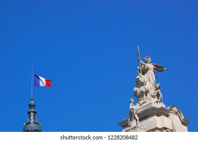 Paris, France / France - 12th August 2012: Flag of France flying above Grand Palais Champs-Élysées in the 8th arrondissement