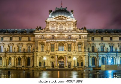 Paris, France - 13 February 2016: The famous square courtyard building of the Louvre Museum at night.