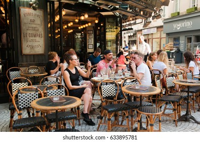 PARIS, FRANCE - 13 SEPTEMBER, 2016: Typical bar in the old town of Paris, France on 13 September 2016.  Paris is one of the most populated metropolitan areas in Europe full of bars and cafes.