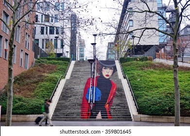 PARIS, FRANCE -15 DEC 2015- La Parisienne street art wall painting of a staircase in anamorphosis by muralists Zag and Sia on Rue du Chevaleret in the 13th arrondissement of Paris.