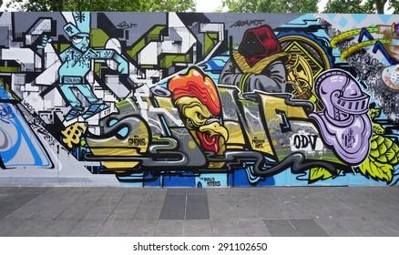PARIS, FRANCE -15 JUNE 2015- Colorful street art around the rue Jean Poulmarch in the 10th arrondissement of Paris near the Place de la Republique.