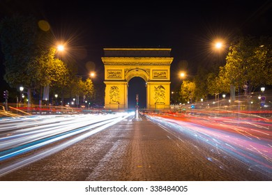 Paris, France - 15 October 2014. Arc de triomphe Paris city at nightt - Arch of Triumph and Champs Elysees. Long Exposure