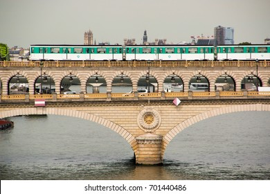 Paris (France), 16 august 2017. Train from line 6 of the Paris subway network crossing the Seine on the bridge of Bercy.