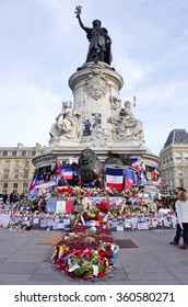 PARIS, FRANCE -17 DEC 2015- The statue on the Place de la Republique in Paris has become an informal memorial with flowers, flags and messages for the victims of the November terror attacks in Paris.