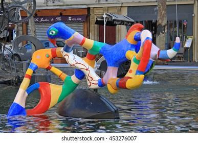 PARIS, FRANCE -17 DECEMBER 2011: The Stravinsky Fountain near the Centre Georges Pompidou by sculptors Jean Tinguely and Niki de Saint Phalle