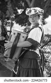 PARIS, FRANCE - 17th of September 2014: Unknown woman playing accordion  on Montmartre hill 17th of September 2014 in PARIS, FRANCE (black and white)