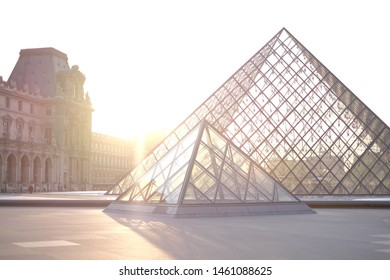 Paris, France - 18 Apr 2018: Aerial view of the most famous triangle architecture in the world. Louvre Museum (Musee du louvre) with Beautiful Warmlight Clear Sky at Evening.