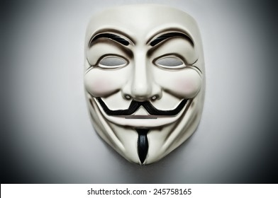 Paris - France - 18 January 2015 - Vendetta mask on white bacground . This mask is a well-known symbol for the online hacktivist group Anonymous