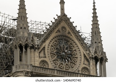 PARIS, FRANCE - 19 APRIL 2019 Notre Dame cathedral, after the timber roof caught fire. Scorched marks showing the damage to the stone work., and the melted scaffolding behind it.