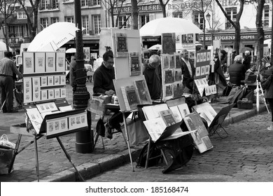 PARIS, FRANCE - 19TH MARCH 2014: Artists painting down Place du Tertre in Paris during the day