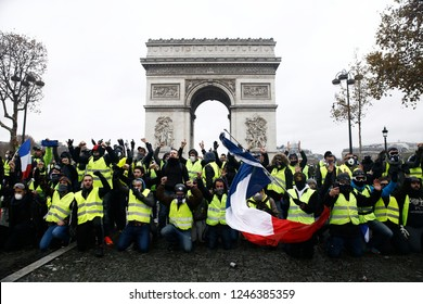 Paris, France.  1st December 2018. People take part in a protest march of the yellow vests  against the rising of the fuel and oil prices.