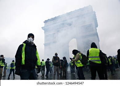 Paris, France.  1st December 2018. Riot Police uses a water canon and tear gas against demonstrators during  a protest against the rising of the fuel and oil prices by people wearing yellow vests.