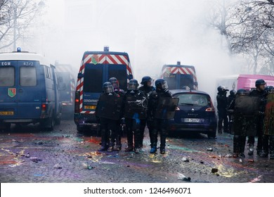 Paris, France.  1st December 2018. Police forces intervene in a protest against the rising of the fuel and oil prices by people wearing yellow vests.