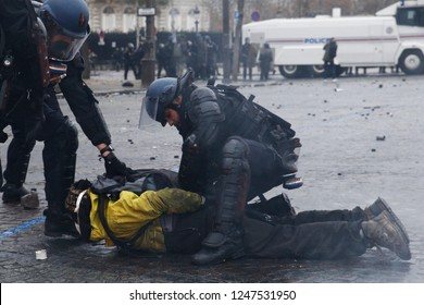 Paris, France. 1st December 2018.  People clashed with Riot Police during a protest against the rising of the fuel and oil prices by people wearing yellow vests.