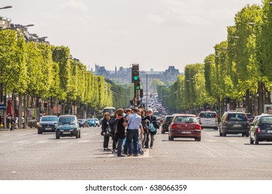 Paris France 20 April 2014 Paris streets are a tourist delight filled with people and history everywhere you look