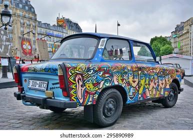 PARIS, FRANCE -20 JUNE 2015- Art Liberte du Mur de Berlin au Street Art exhibits street art and painted Trabant cars around the Gare de Est railway station in the 10th arrondissement of Paris.
