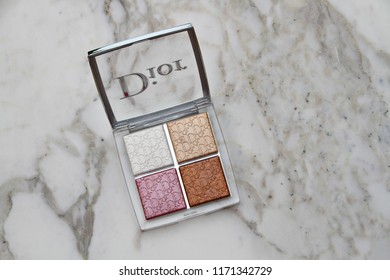PARIS, FRANCE - 20 JUNE 2018: A pallet of Dior Backstage Glow Face highlight & blush. Dior is a European luxury goods company with revenues of $41.6 billion and almost 85,000 employees. Editorial.