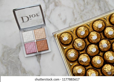 PARIS, FRANCE - 20 JUNE 2018: A pallet of Dior Backstage Glow Face & box of Ferrero Rocher. Dior is a European luxury goods company with revenues of $41.6 billion & almost 85,000 employees. Editorial.