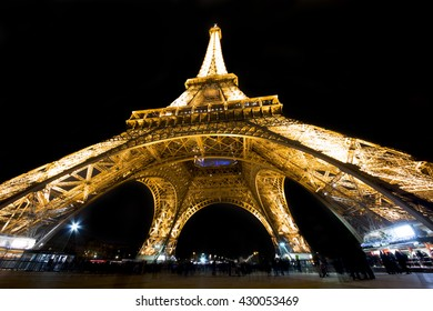 Paris, France 20 May 2016. Eiffel Tower illuminated at night seen from below. The Eiffel tower is the symbol of Paris visited by millions of tourists